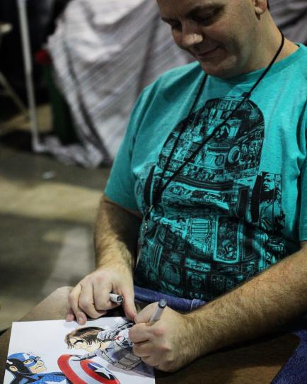 Robert Baker (@RobertBakerArt) finishing a piece of Captain America art at his table at @amazingcomiccon in Phoenix, Arizona on February 12.