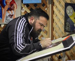 Michah Garcia working on his duct tape art at Amazing Arizona Comic Con in Phoenix, Arizona on February 12. AACC was Garcia's first convention as an exhibitor.