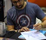 @dutchwho / @dutchwhat working on a piece of Deadpool artwork at @amazingcomiccon in Phoenix, Arizona on February 12.