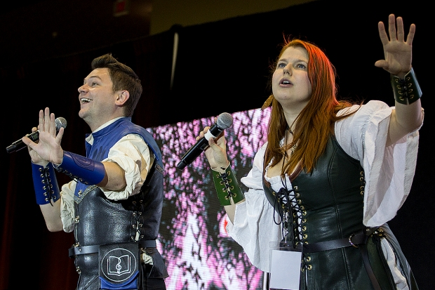 The Library Bards, Xander Jeanneret and Bonnie Gordon, perform their parody songs on the main stage during Amazing Arizona Comic Con at the Phoenix Convention Center on February 12. The Library Bards parodies include songs about cosplay, video games and shipping characters from Star Wars.