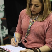 Skylar Patridge (@skyepatridge) working on a Harley Quinn cover sketch at her table during @amazingcomiccon in Phoenix, Arizona on February 13.