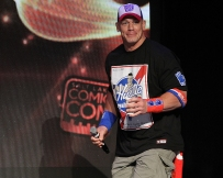 John Cena sneaking on stage while being introduced for his panel at Salt Lake Comic Con on September 2. Salt Lake Comic Con was held at the Salt Palace Arena in Salt Lake City from September 1 through 3. / Photo by Stephan Starnes