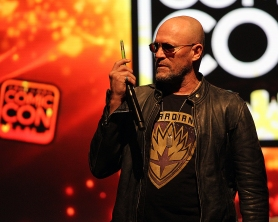 Michael Rooker speaks on his phone to a friend pretending to be Chris Pratt at his panel at Salt Lake Comic Con on September 3. Salt Lake Comic Con was held at the Salt Palace Arena in Salt Lake City from September 1 through 3. / Photo by Stephan Starnes